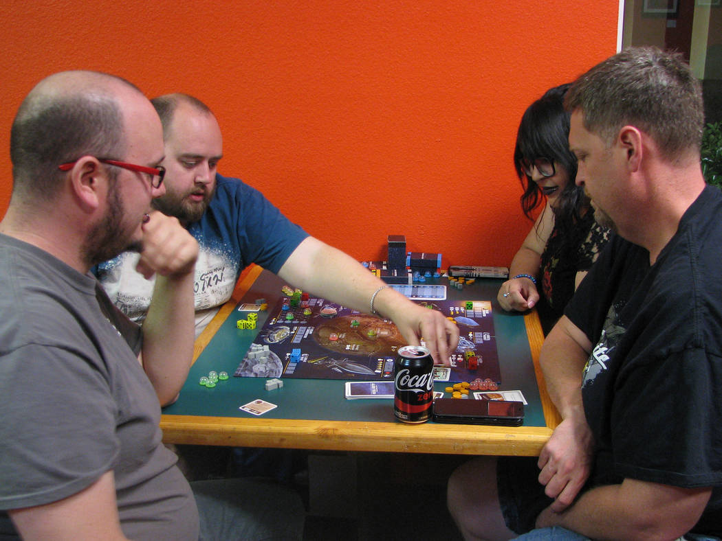 """Customers play a game of """"Alien Frontiers"""" at Meepleville, 4704 W. Sahara Ave. (F. Andrew Taylor/View) @FAndrewTPress"""
