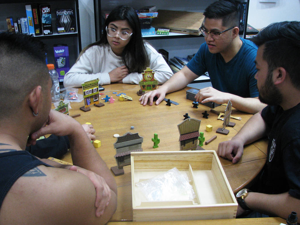 """Customers play a game of """"Flick 'Em Up."""" at Meepleville, 4704 W. Sahara Ave. (F. Andrew Taylor/View) @FAndrewTPress"""