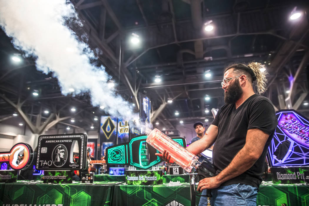 Jorge Matto, with LIV nightclub in Miami, FL., fires an airgun during the 2017 Nightclub & Bar Show at the Las Vegas Convention Center on Tuesday, March 29, 2017, in Las Vegas. (Benjamin Hager ...