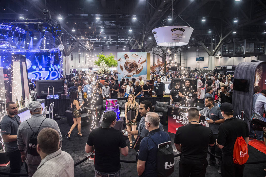 Representatives from Sparktacular engage attendees at the 2017 Nightclub & Bar Show at the Las Vegas Convention Center on Tuesday, March 29, 2017, in Las Vegas. (Benjamin Hager/Las Vegas Revie ...