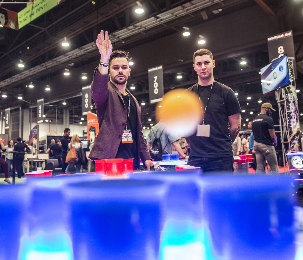 Micky Valens, left, and Simeon Biggs play a game of PowerPong during the 2017 Nightclub & Bar Show at the Las Vegas Convention Center on Tuesday, March 29, 2017, in Las Vegas. (Benjamin Hager/ ...
