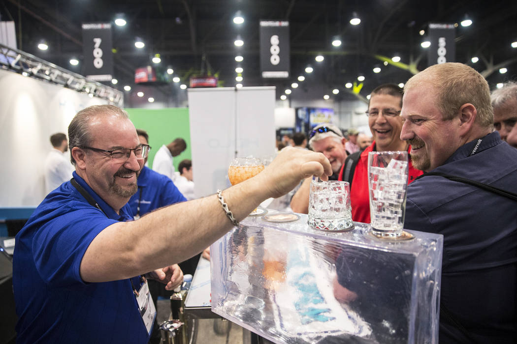 Manitowoc Ice distributor Pete Palm, left, highlights the different shapes and sizes of ice his trays produce during the 2017 Nightclub & Bar Show at the Las Vegas Convention Center on Tuesday ...