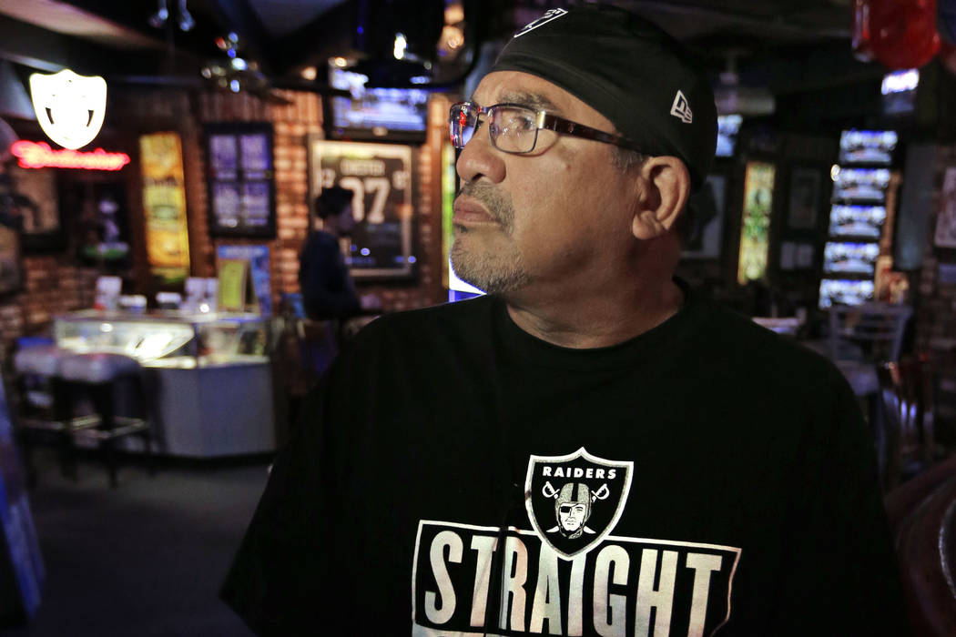 Oakland Raider fan Robert Morales watches a television broadcast announcing the Raiders move to Las Vegas has been approved Monday, March 27, 2017, at Ricky's Sports Theatre & Grill in San Lea ...