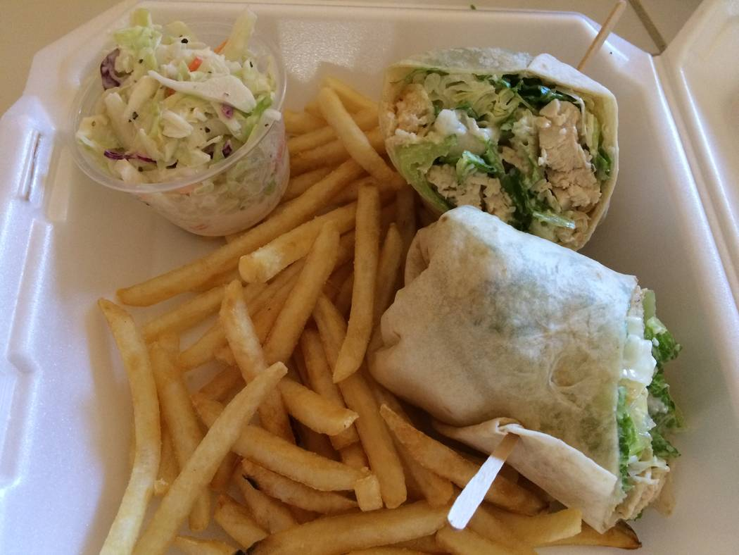Norm's Diner serves its chicken Caesar wrap with fries and cole slaw.