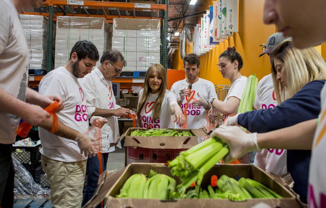 Volunteers bag stalks of celery during Good Deeds Day at Three Square Food Bank in Las Vegas, Sunday, April 2, 2017. (Elizabeth Brumley Las Vegas Review-Journal) @EliPagePhoto