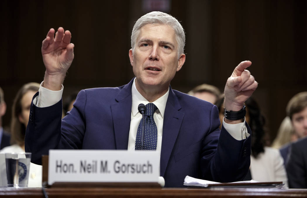 FILE - In this March 22, 2017, file photo, Supreme Court Justice nominee Judge Neil Gorsuch testifies on Capitol Hill in Washington, at his confirmation hearing before the Senate Judiciary Committ ...