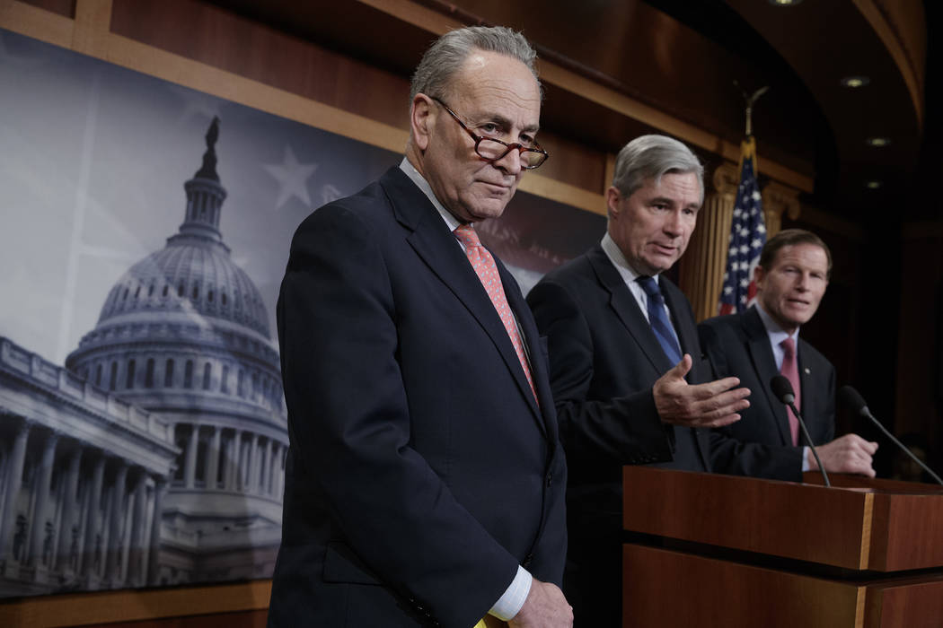 Senate Minority Leader Chuck Schumer, D-N.Y., center, joined by Judiciary Committee members Sen. Sheldon Whitehouse, D-R.I., and Sen. Richard Blumenthal, D-Conn., far right, talk to reporters abou ...