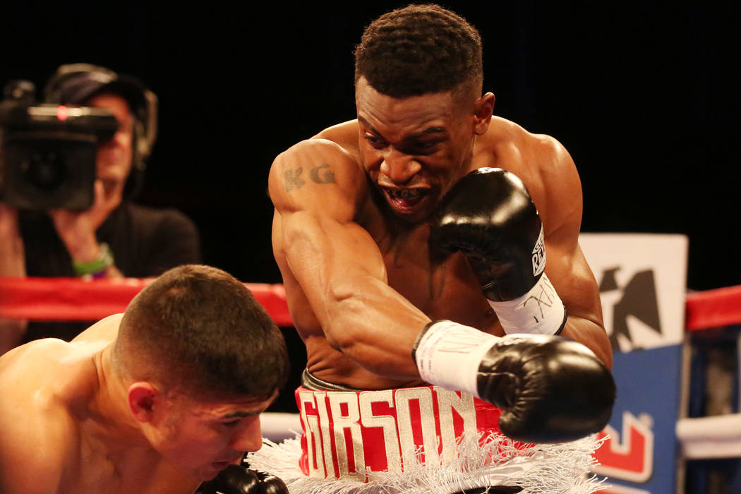 KeAndre Gibson, right, hits Antonio Orozco during their super lightweight match at The Chelsea at The Cosmopolitan hotel-casino on Saturday, April 1, 2017, in Las Vegas. Orozco had a knockout win. ...