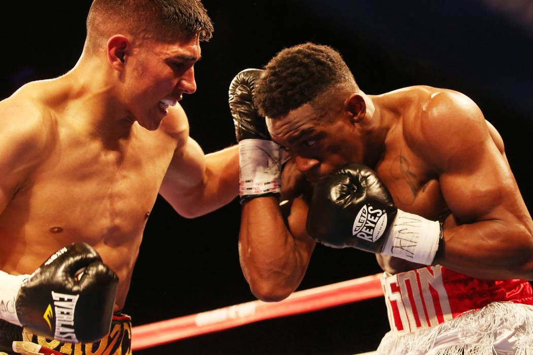 Antonio Orozco, left, hits KeAndre Gibson during their super lightweight match at The Chelsea at The Cosmopolitan hotel-casino on Saturday, April 1, 2017, in Las Vegas. Orozco had a knockout win.( ...