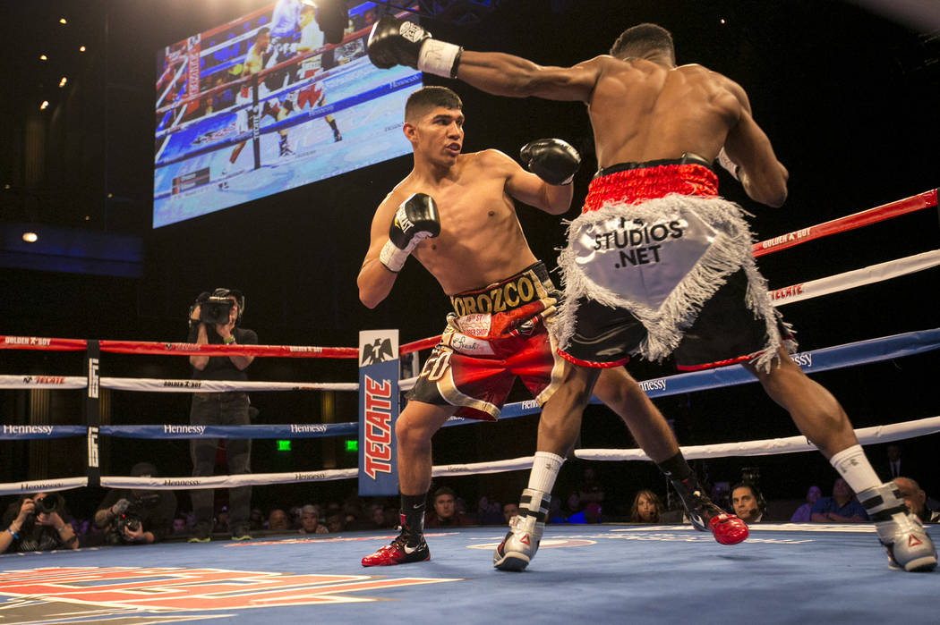 Antonio Orozco, left, and KeAndre Gibson, right, alternate hits during their super lightweight match at The Chelsea at The Cosmopolitan hotel-casino on Saturday, April 1, 2017, in Las Vegas. Orozc ...