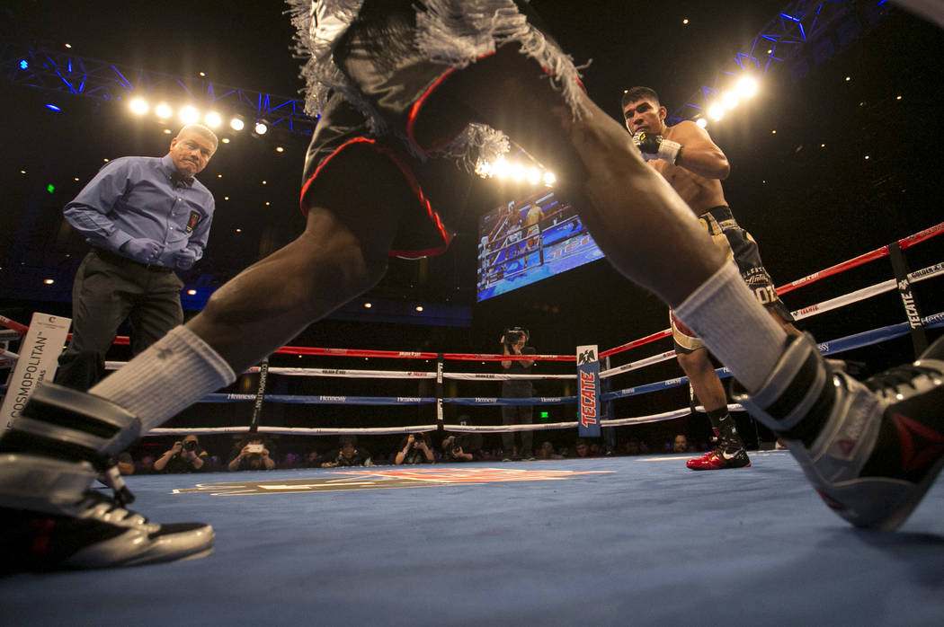 Antonio Orozco, right and KeAndre Gibson dance around the ring during their super lightweight match at The Chelsea at The Cosmopolitan hotel-casino on Saturday, April 1, 2017, in Las Vegas. Orozco ...