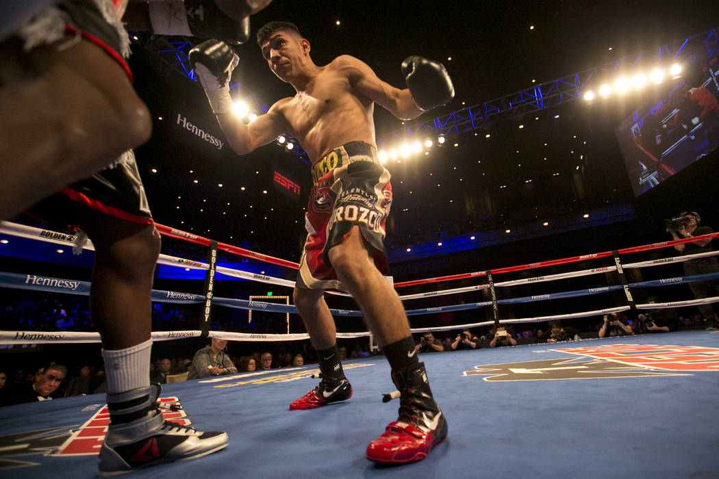 Antonio Orozco, right, prepares to hit KeAndre Gibson during their super lightweight match at The Chelsea at The Cosmopolitan hotel-casino on Saturday, April 1, 2017, in Las Vegas. Orozco had a kn ...