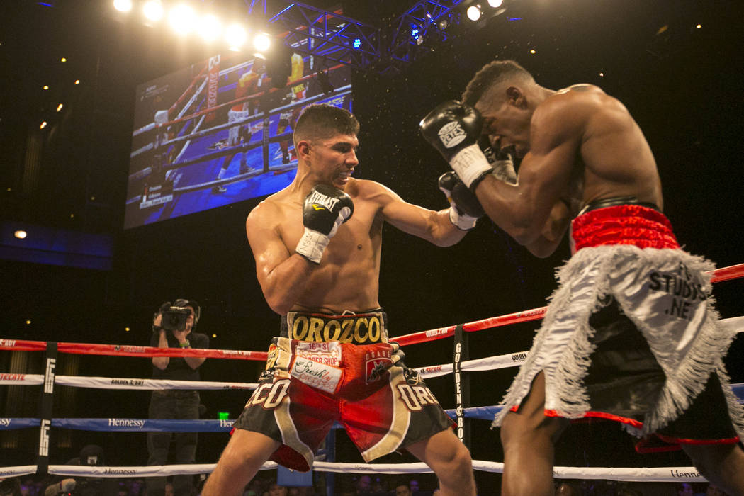 Antonio Orozco, left, swings at KeAndre Gibson during their super lightweight match at The Chelsea at The Cosmopolitan hotel-casino on Saturday, April 1, 2017, in Las Vegas. Orozco had a knockout  ...
