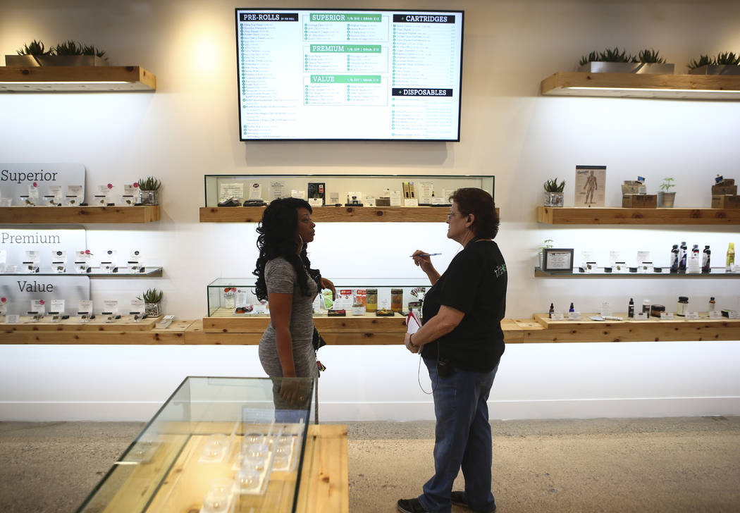 Patient advisor Carol Booth, right, assists Jennifer, who declined to give her last name, at medical marijuana dispensary The Source in Las Vegas on Thursday, March 30, 2017. (Chase Stevens/Las Ve ...