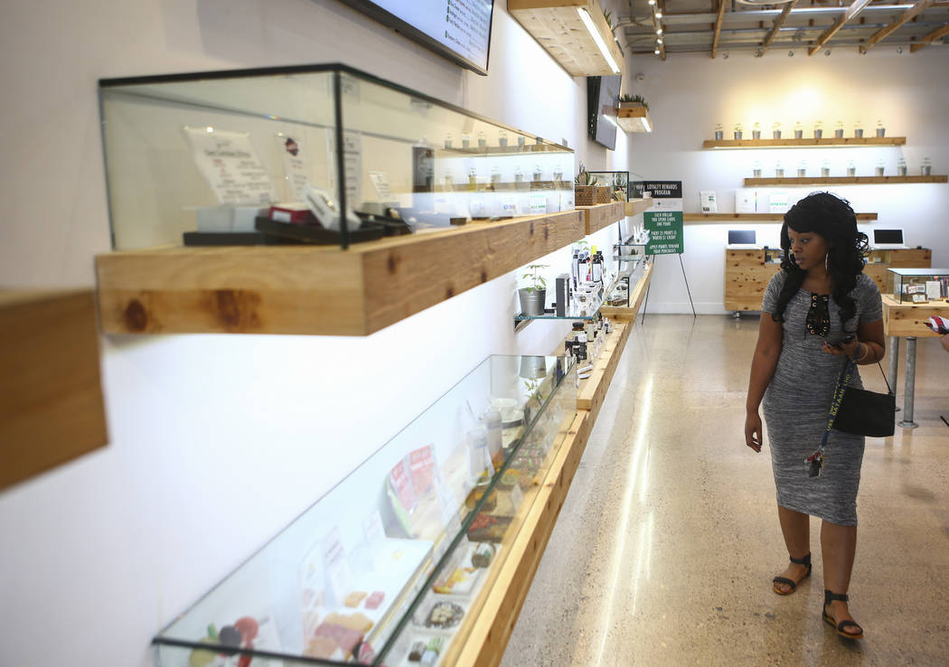 Jennifer, who declined to give her last name, browses through products at medical marijuana dispensary The Source in Las Vegas on Thursday, March 30, 2017. (Chase Stevens/Las Vegas Review-Journal) ...