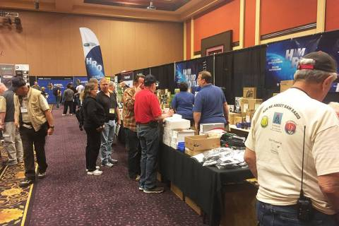 Attendees view the wares April 1 on the second day of the three-day American Radio Relay League ...