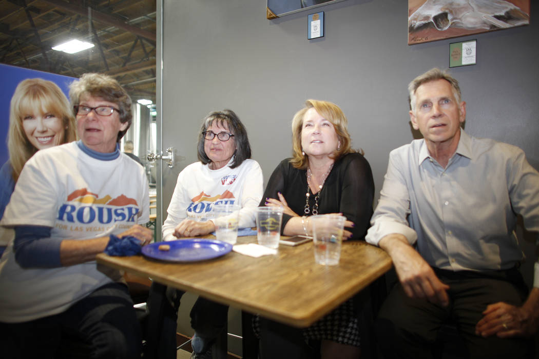 Kathy Utiger, from left, Pauline Autonakos, Julie Gilday-Shaffer and Vince Shaffer watch results come in at the watch party for Las Vegas Ward 2 City Council candidate Christina Roush at Tenaya Cr ...
