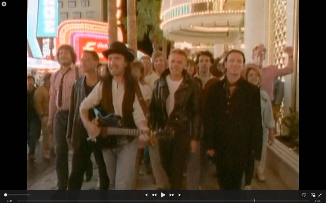 """A scene from U2's  iconic """"I Still Haven't Found What I'm Looking For"""" video filmed on Fremont Street on April 12, 1987."""