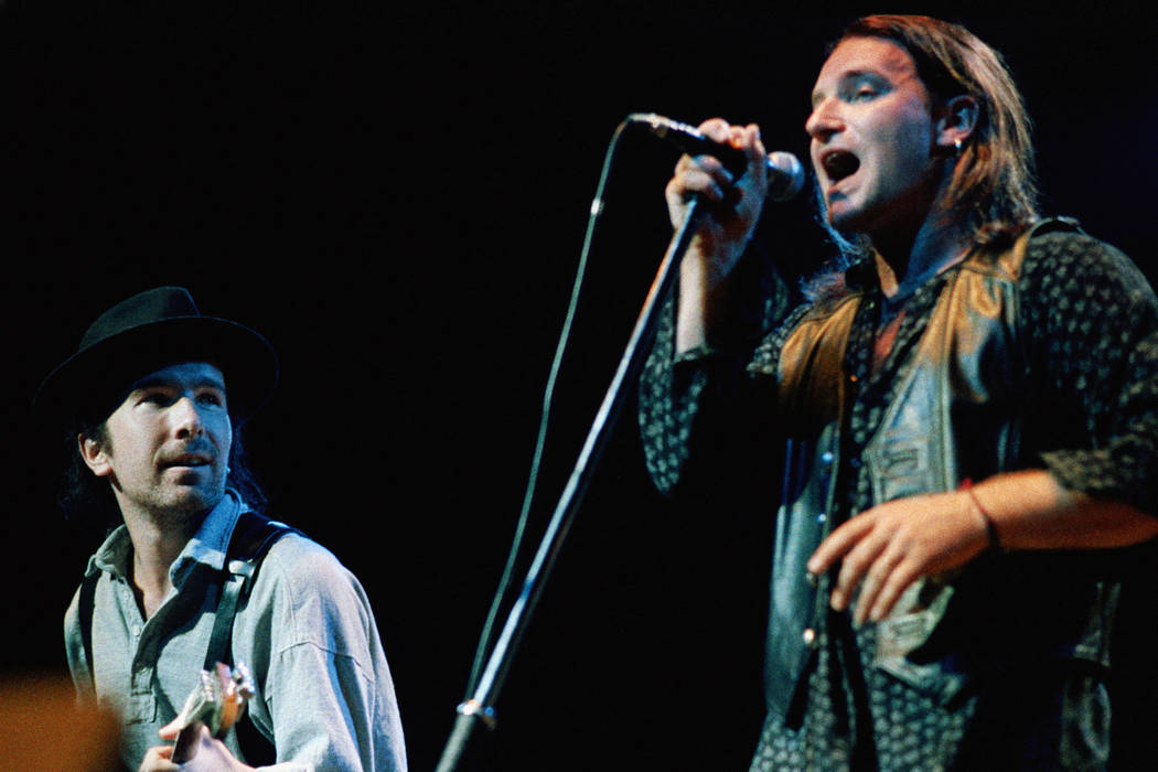 Bono, lead singer of the rock band U2 and The Edge (left) opened their world tour, April 3, 1987, before a sold out crowd at the Activity Center on the campus of Arizona State University in Tempe. ...