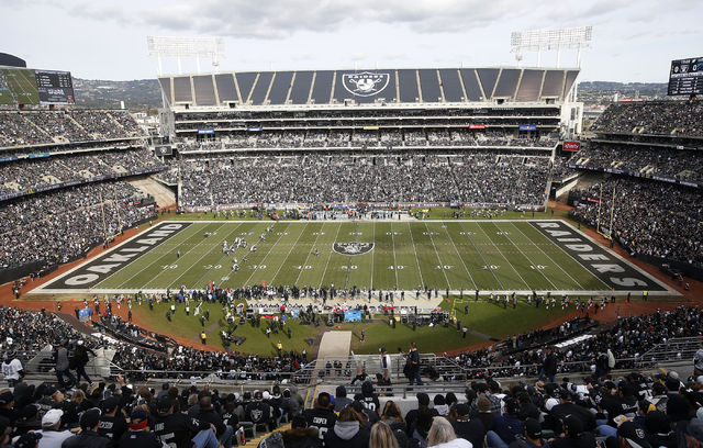 Fans watch during the first half of an NFL football game between the Oakland Raiders and the Carolina Panthers from a general view of Oakland Alameda County Coliseum in Oakland, Calif., Sunday, No ...