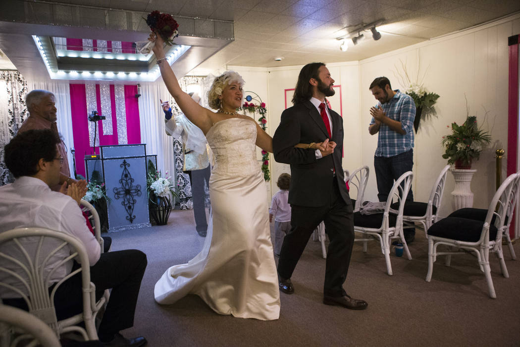 Lauren Santiago, left, and David Wenzel during their wedding ceremony at the Little Vegas Chapel in Las Vegas on Saturday, April 1, 2017. (Chase Stevens/Las Vegas Review-Journal) @csstevensphoto