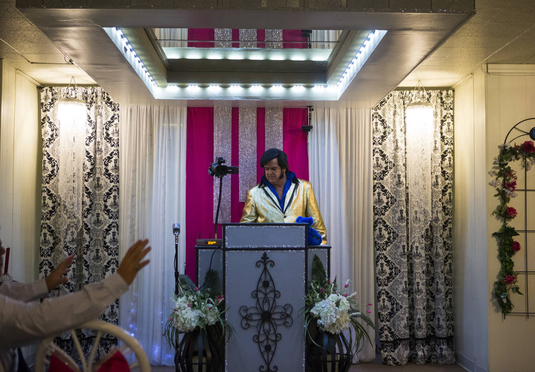 Elvis impersonator and wedding officiant Tim Ritchey prepares for a ceremony at the Little Vegas Chapel in Las Vegas on Saturday, April 1, 2017. (Chase Stevens/Las Vegas Review-Journal) @csstevens ...