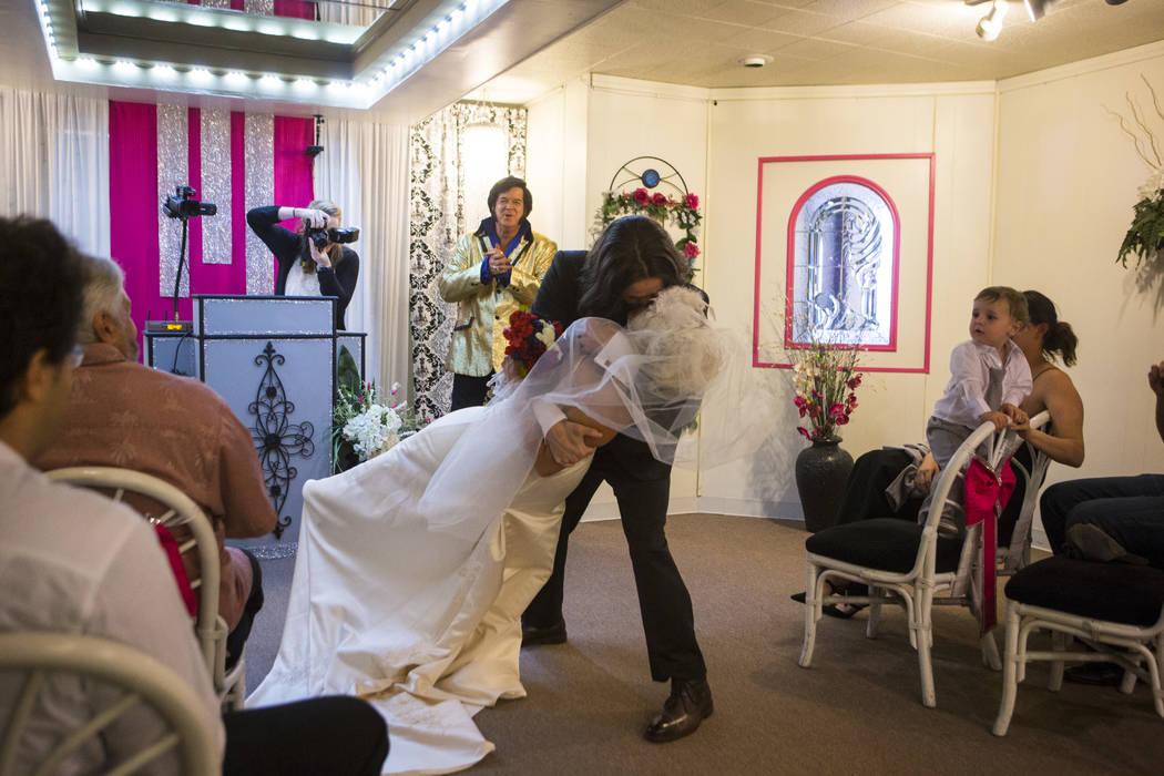 Lauren Santiago and David Wenzel kiss during their wedding ceremony at the Little Vegas Chapel in Las Vegas on Saturday, April 1, 2017. (Chase Stevens/Las Vegas Review-Journal) @csstevensphoto