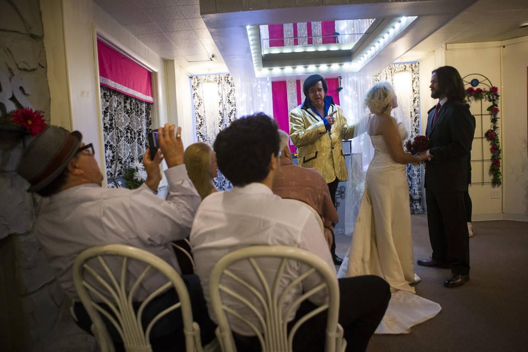 Lauren Santiago and David Wenzel during their wedding ceremony at the Little Vegas Chapel in Las Vegas on Saturday, April 1, 2017. (Chase Stevens/Las Vegas Review-Journal) @csstevensphoto