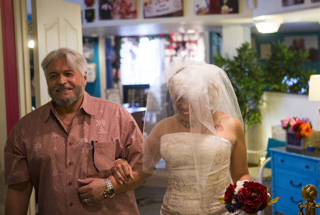 Lauren Santiago is walked down the aisle by her father George during her wedding ceremony at the Little Vegas Chapel in Las Vegas on Saturday, April 1, 2017. (Chase Stevens/Las Vegas Review-Journa ...