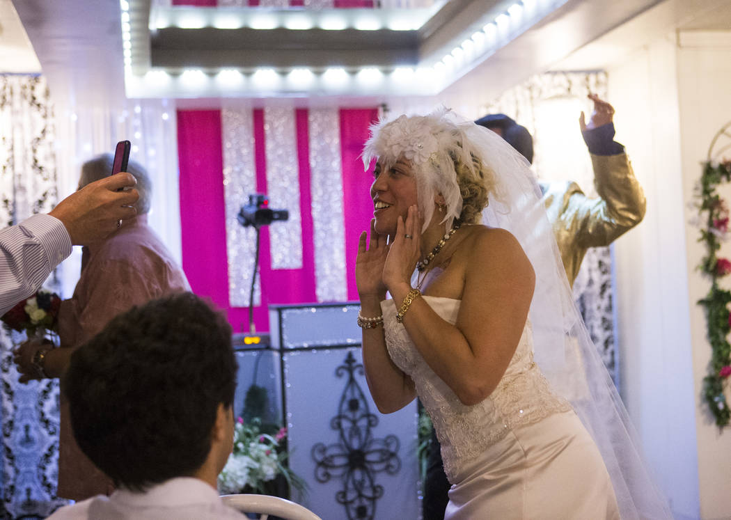 """Lauren Santiago responds to a Facebook Live stream saying """"it's for real"""" during their wedding at the Little Vegas Chapel in Las Vegas on Saturday, April 1, 2017. (Chase Stevens/ ..."""