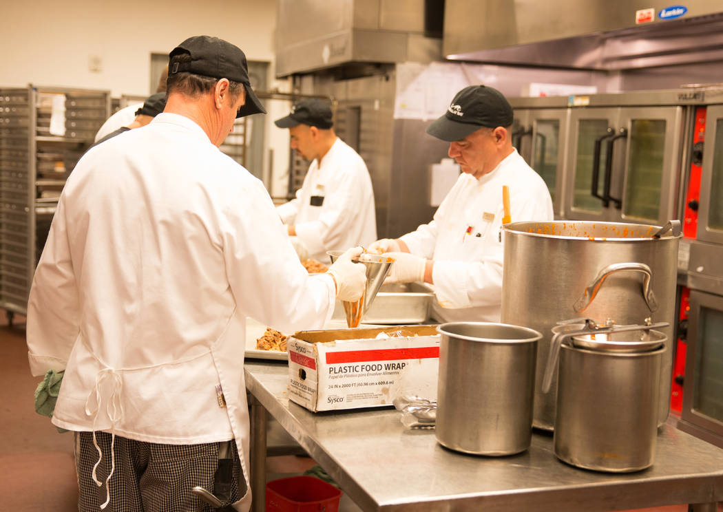Line cooks preparing food in the hot kitchen for 3,000 people at the Mandalay Bay. Todd Prince Las Vegas Review-Journal