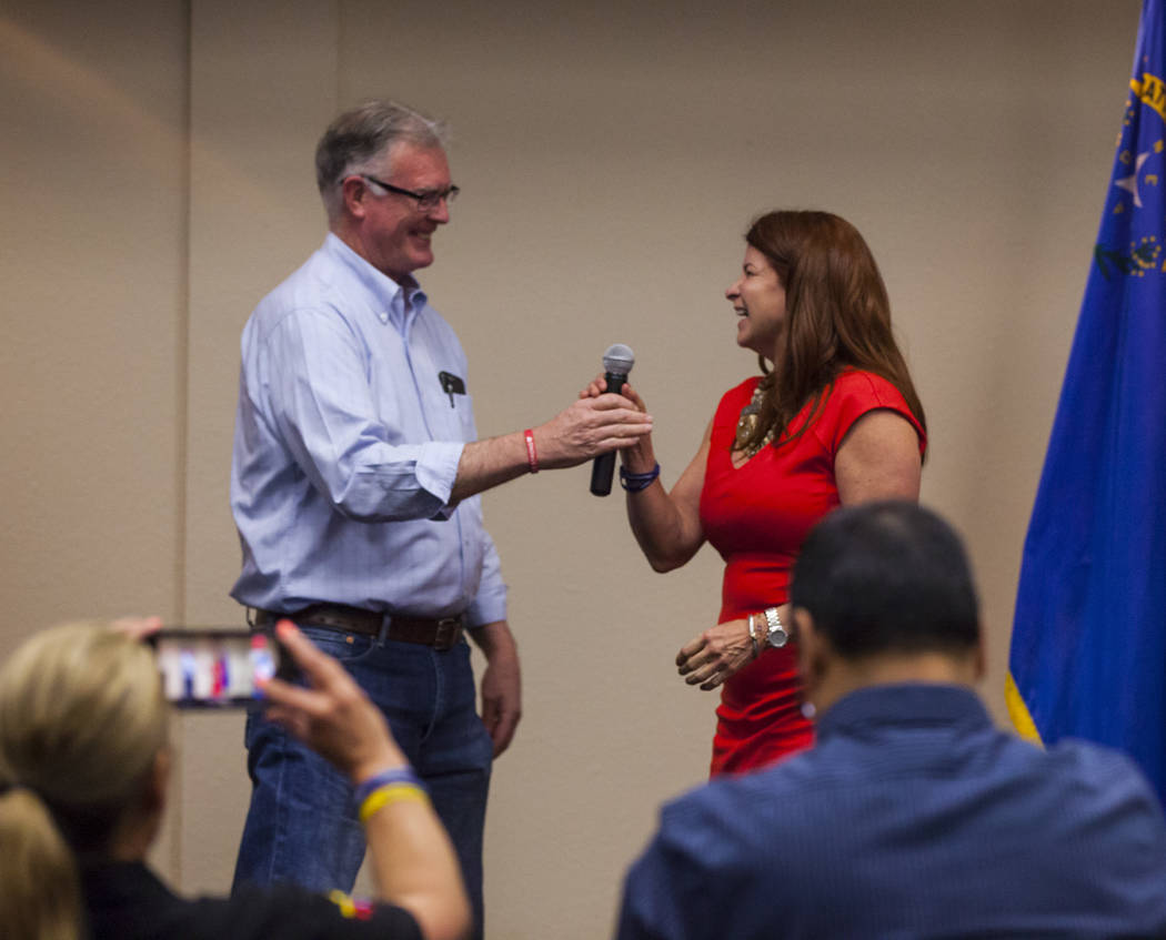 Henderson Ward 2 City Councilwoman and mayoral candidate Debra March on stage at her watch party with termed-out Henderson Mayor Andy Hafen after early polling results put her in the lead at the H ...