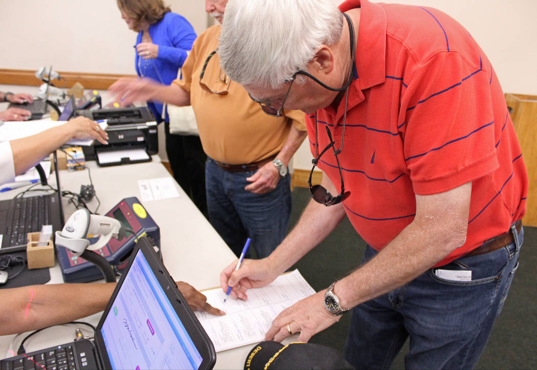 Mayoral candidate Rick Workman signs in to vote at the Sun City MacDonald Ranch, Tuesday, April 4, 2017. Gabriella Benavidez Las Vegas Review-Journal @gabbydeebee
