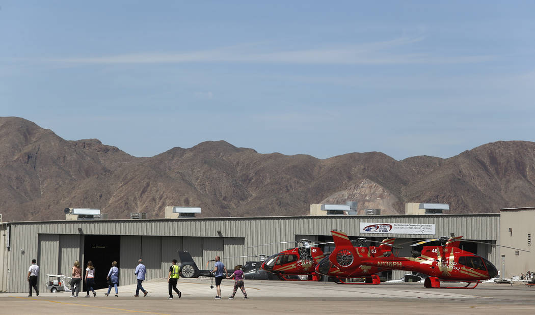 Passengers prepare to board a Grand Canyon Scenic Airline helicopter at the Boulder City Municipal Airport on Wednesday, April 5, 2017, in Boulder City. Christian K. Lee Las Vegas Review-Journal @ ...