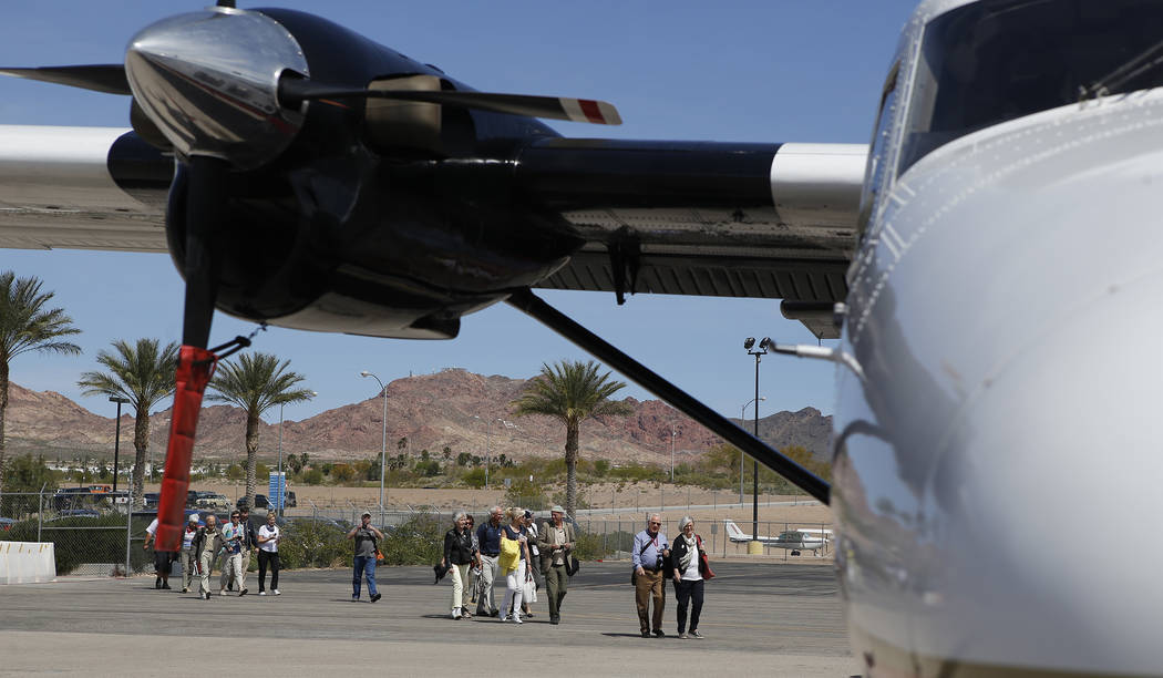 Passengers prepare to board a Grand Canyon Scenic Airline plane at the Boulder City Municipal Airport on Wednesday, April 5, 2017, in Boulder City. Christian K. Lee/Las Vegas Review-Journal @chris ...