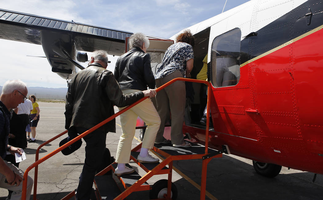 Passengers board a Grand Canyon Scenic Airline helicopter at the Boulder City Municipal Airport on Wednesday, April 5, 2017, in Boulder City, Nevada. Christian K. Lee/Las Vegas Review-Journal @chr ...