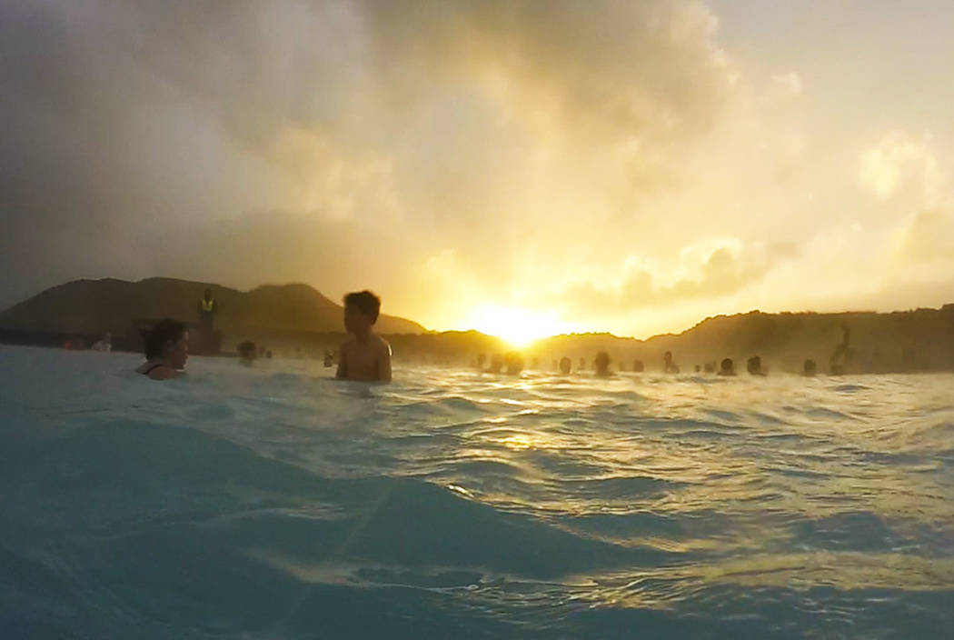 Guests relax in the Blue Lagoon geothermal hot spring in Grindavík, Iceland at sunset. (Janna Karel/Las Vegas Review-Journal)