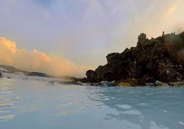 Guests relax in the Blue Lagoon geothermal hot spring in Grindavík, Iceland at sunset on December 20, 2017. (Janna Karel/Las Vegas Review-Journal)