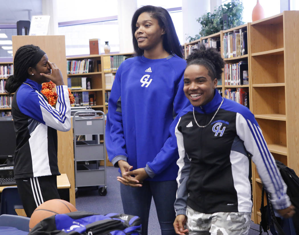 Dayonna Maddox, 18, from left, Yemiyah Morris, 18, and D'Licya Feaster, 18, announced they will be playing basketball for Grays Harbor College at Canyon Springs High School on Monday, April 3, 201 ...
