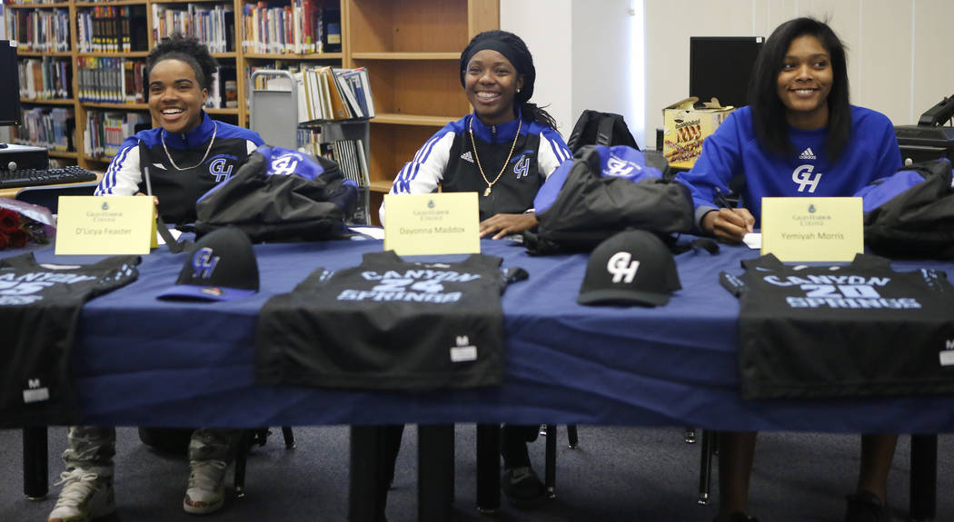 D'Licya Feaster, 18, from left, Dayonna Maddox, 18, and Yemiyah Morris, 18, announce they will be playing basketball for Grays Harbor College at Canyon Springs High School on Monday, April 3, 2017 ...