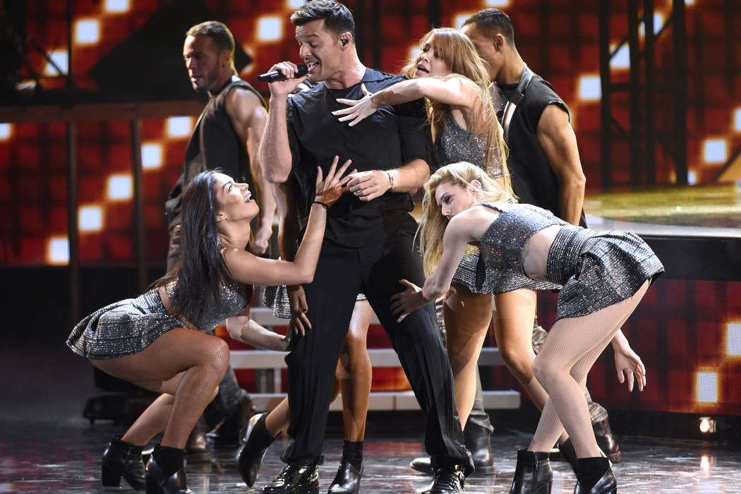 Ricky Martin performs a medley at the 16th annual Latin Grammy Awards at the MGM Grand Garden Arena on Thursday, Nov. 19, 2015, in Las Vegas. (Chris Pizzello]/Invision/AP)