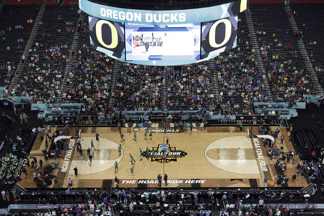 Oregon players warm up during a practice session for their NCAA Final Four tournament college basketball semifinal game Friday, March 31, 2017, in Glendale, Ariz. (Morry Gash/AP)