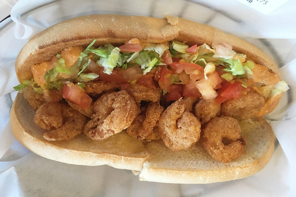 The shrimp po' boy at Hot N Juicy Crawfish had an ample supply of fried shrimp but was a bit dry. (Brian Sandford/View)