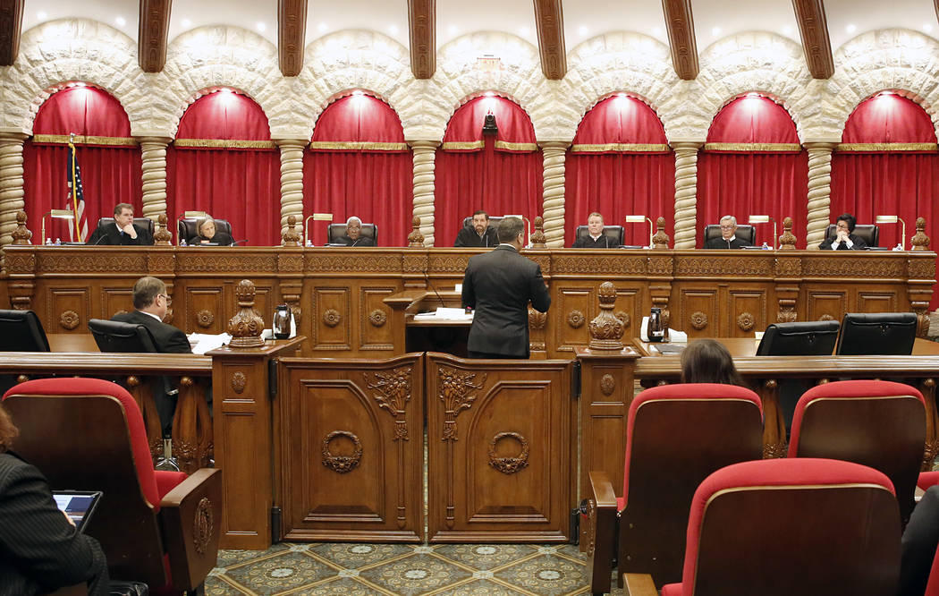 The Nevada Supreme Court hear arguments from defense attorney Christopher Oram, center, for the first time in the new Supreme Court building on Monday, April 3, 2017, in Las Vegas. Bizuayehu Tesfa ...