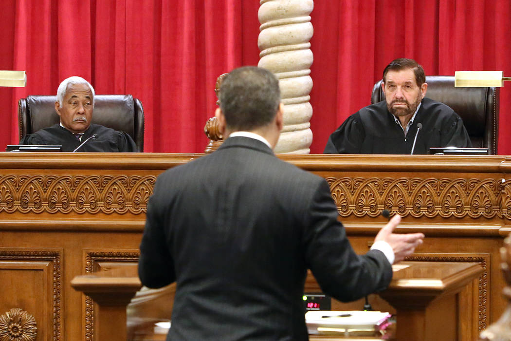 Nevada Supreme Court Justices Michael Douglas, left, and Michael Cherry hear arguments from appellate defense attorney Christopher Oram for the first time in the new Supreme Court building on Mond ...