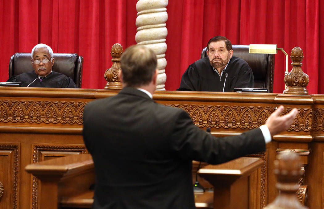 Nevada Supreme Court Justices Michael Douglas, left, and Michael Cherry hear arguments from Steven Owens, appellate chief deputy district attorney, for the first time in the new Supreme Court buil ...