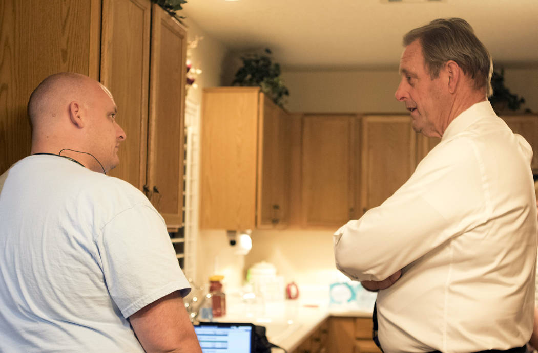 Mayor of North Las Vegas John Lee, right, who is running for a second term, talks over early election results with city council nominee Scott Black's campaign manager on Tuesday, April 4, 2017.  H ...