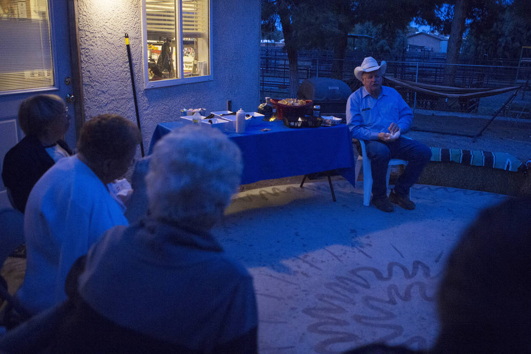 North Las Vegas city council ward 3 candidate Tom Collins, right, gathered with friends and family to wait for the election on Tuesday, April 4, 2017, in Las Vegas as his home. (Bridget Bennett/La ...