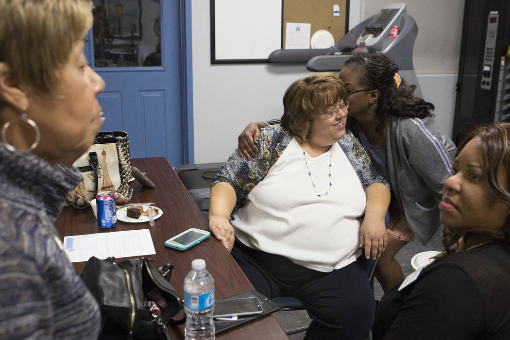 North Las Vegas city council ward 3 candidate Anita Wood   a kiss from supporter Pamela Baxter during a North Las Vegas Democratic Club is meeting Tuesday, April 4, 2017, in Las Vegas. (Bridget Be ...