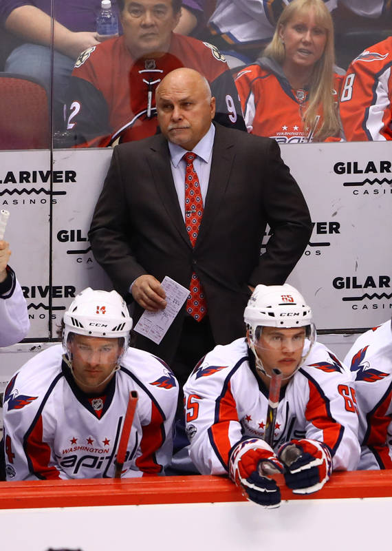 Mar 31, 2017; Glendale, AZ, USA; Washington Capitals head coach Barry Trotz stands behind right wing Justin Williams (14) and left wing Andre Burakovsky (65) on the bench in the second period agai ...